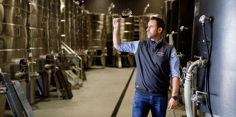 Trevor Durling Sampling Wine in Cellar